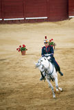 Rider on a white horse. Real equestrian gala held on June 16 of 2012 in Jerez de la Frontera. Rider on a white horse of pure breed, with the uniform of the royal Royalty Free Stock Photo