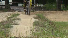 Rider in yellow sport suit races against time circuit race. Stock footage stock video