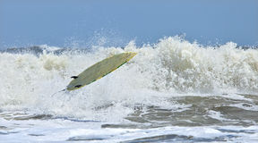 Riderless surfboard in air Stock Images