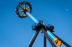Riders at amusement park Stock Photo