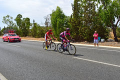 Manzana Postobon And Cofidis Riders Ahead Of Team Car Royalty Free Stock Image