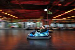 Riders in bumper car Stock Image