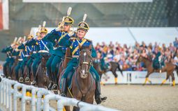 Riders of cavalry honorary escort of Presidential. MOSCOW, RUSSIA - SEPTEMBER 7.  Riders of cavalry honorary escort of Presidential Regiment at Military Music Stock Image