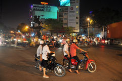 Riders celebration in saigon. When vietnamese team won the friendly soccer match.everybody ride to street and celebrating.You'll see  how terrible is the city of Stock Photo