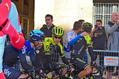 Riders Chat Before The Start Of A Cycle race. The race ledaers in the narrow street before the start the Vuelta a Valencia bike race in Alicante Spain royalty free stock images