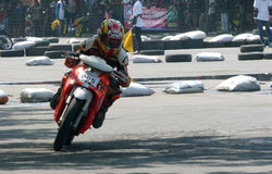 Riders. Are competing in the road race at a circuit in the city of Solo, Central Java, Indonesia Royalty Free Stock Image
