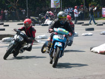 Riders. Are competing in the road race at a circuit in the city of Solo, Central Java, Indonesia Stock Image
