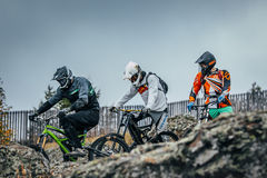 Riders downhill bikes prepare to descend Royalty Free Stock Images