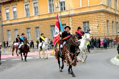 Riders in downtown Brasov Royalty Free Stock Photos