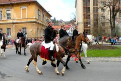 Riders in downtown Brasov Stock Photos