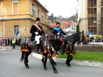 Riders in downtown Brasov Royalty Free Stock Photography