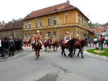 Riders in downtown Brasov Royalty Free Stock Image