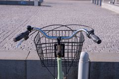 A Riders eye viewpoint of a set of curved handlebars and a baske royalty free stock photos