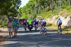 Riders Holding Onto Police Motorcycle La Vuelta España Royalty Free Stock Photos