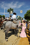 Riders at horse in the Seville Fair, feast in Spain Royalty Free Stock Images