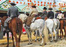 Riders on horseback during the Seville Fair, Andalusia, Spain Royalty Free Stock Photos