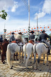 Riders on horseback during the Seville Fair, Andalusia, Spain Stock Images