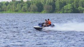 Riders on jet ski on lake. stock video