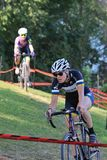 Riders navigate the obstacle course at a Cycling Race. September 10, 2017 - Cyclocross extreme cycling on the challenging race terrain Royalty Free Stock Image