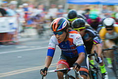 Riders of a pack. BOISE, IDAHO-JULY 16 2016: Pack of riders making their way through a turn stock images