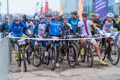 Riders preparing to start mountain bike contest. Mountain bike contest on unfinished construction. First edition of Urban Trail Cross Country Short Circuit - XCC Royalty Free Stock Photo