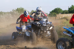 Riders on quad bikes. Intense competition riders on quad bikes Royalty Free Stock Image