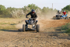 Riders on quad bikes. Intense competition riders on quad bikes Royalty Free Stock Photo