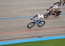 Riders race on Velodrome Track Stock Photos