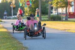 Riders on recumbent bikes. stock images