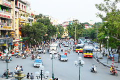 Riders ride motorbikes on busy road, Hanoi Royalty Free Stock Image