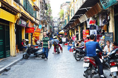 Riders ride motorbikes on busy road, Hanoi Royalty Free Stock Photography