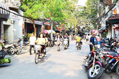 Riders ride motorbikes on busy road, Hanoi Stock Photography
