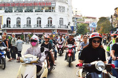 Riders ride motorbikes on busy road, Hanoi Stock Photos
