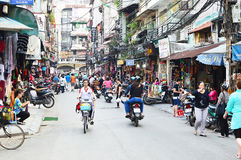 Riders ride motorbikes on busy road, Hanoi Royalty Free Stock Photo