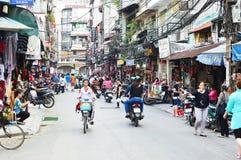 Riders ride motorbikes on busy road, Hanoi Royalty Free Stock Photo
