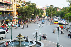 Riders ride motorbikes on busy road, Hanoi Royalty Free Stock Images
