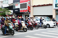 Riders ride motorbikes on busy road, Hanoi Stock Images