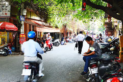 Riders ride motorbikes on busy road, Hanoi Stock Image