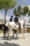 Riders in Seville. Riders taking a walk by the fair of Seville Royalty Free Stock Image