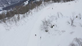 Riders skiing from the mountains of ski resort. Aerial view. Riders riding from the mountains of ski resort. Aerial view stock video