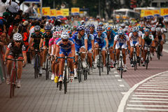 Riders at the start-finish line. At the start-finish line going into the final lap. This is the seventh stage of the international bicycle race, le Tour de Royalty Free Stock Photo
