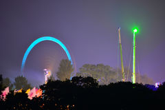 Rides at the Isle of Wight Festival. Fairground rides create silhouettes with trees at the Isle of Wight Festival in Newport, Isle of Wight, Uk Stock Images