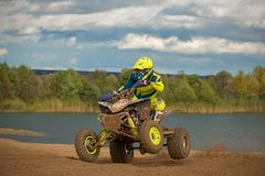 Rides on two wheels. SERPUKHOV, RUSSIA - OCTOBER 7, 2017: Elagin Yan 737,  Class ATV, in the 4 stage  MX series, the Red Wings Cup 2017 super country-cross, Moto Royalty Free Stock Images