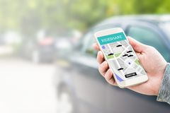 Rideshare taxi app on smartphone screen. Online ride sharing and carpool mobile application. Modern people and commuter transportation service. Man holding stock image