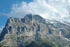Ridge e Eiger alzano in nuvole Grindelwald vicino in Svizzera Fotografia Stock Libera da Diritti