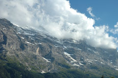Ridge and Eiger peak in clouds nearby Grindelwald in Switzerland Stock Photography