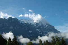 Ridge and Eiger peak in clouds nearby Grindelwald in Switzerland Stock Image