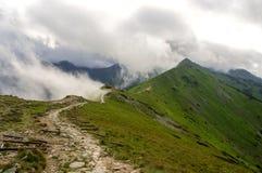 Ridge i molnen västra bergtatra Fotografering för Bildbyråer
