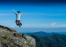Ridge line inspires a leap of joy Stock Image