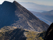 Ridge on mount Snowdon. Ridge on Snowdonia, looking south from the top, with the hikers and scramblers route visible along the ridge and the view of the mountain Royalty Free Stock Photos